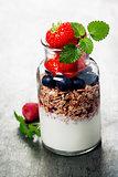 Yogurt with baked granola and berries