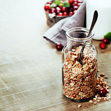 Close up of jar with granola or muesli on table