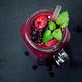 Berry smoothie on rustic background