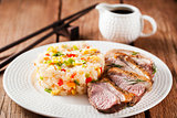 Fried duck  and rice with vegetables and eggs