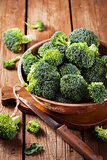 Fresh raw green broccoli in bowl