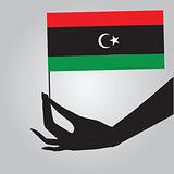 Hand with flag Libya
