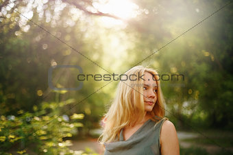 Thoughtful Woman in Summer Sunny Day