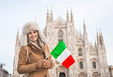 Smiling woman traveler with Italian flag near Duomo, Milan