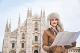 Woman tourist with map looking aside in the front of Duomo