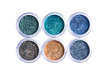 Bright cosmetic glitters in transparent jars