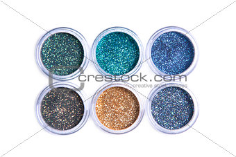 Bright cosmetic glitters in transparent jars