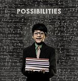 Possibilities. Genius Little Boy Holding Book Wearing Glasses