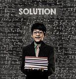 Solution. Genius Little Boy Holding Book Wearing Glasses