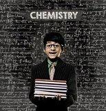 Chemistry. Genius Little Boy Holding Book Wearing Glasses