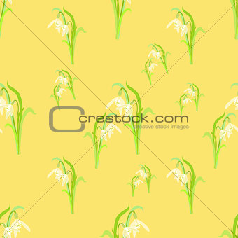 beauty snowdrops on a yellow. seamless vector illustration