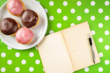 Vintage notebook with recipe for delicious homemade donuts with
