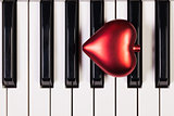 Piano keyboard and red heart