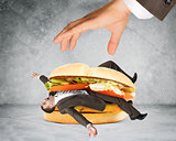 Businessman inside hamburger