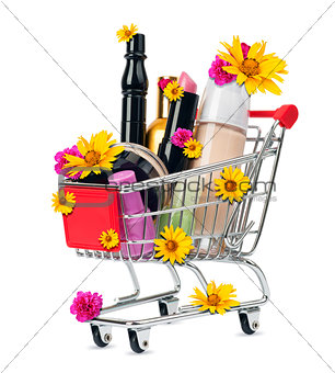 Cosmetics in shopping cart with flowers