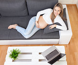 Beautiful pregnant woman relaxing at home