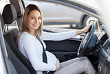 Pregnant woman driving her car