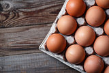 Brown eggs on a rustic wooden table