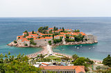 Sveti Stefan island view from hills in windy summer day