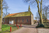 Old church in a street in Oudeschans
