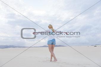 Carefree woman enjoying freedom on beach.