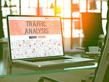Traffic Analysis on Laptop in Modern Workplace Background.