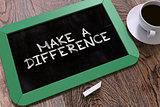 Make a Difference Handwritten on Chalkboard.