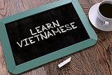 Hand Drawn Learn Vietnamese Concept on Chalkboard.