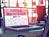 Portfolio Demonstration on Laptop in Modern Workplace Background.