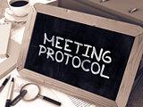 Meeting Protocol Concept Hand Drawn on Chalkboard.