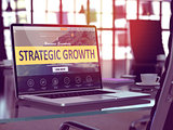 Strategic Growth on Laptop in Modern Workplace Background.