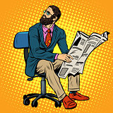Bearded businessman reading a newspaper