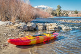 whitewater kayak on river shore