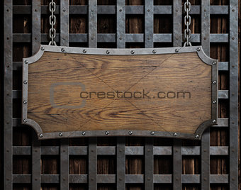 Old wood plate or sign on chain
