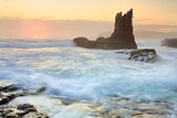 Sun glimpses over the horizon at Cathedral Rock Kiama