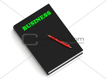 BUSINESS- inscription of green letters on black book