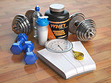 Fitness, bodybuilding or weight loss concept. Weight scales, dum