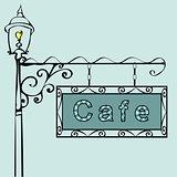 cafe text on vintage street sign