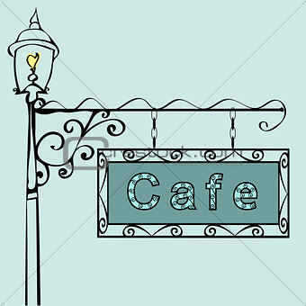 cafe text on vintage street sign