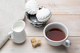 Set of cup black tea and dessert