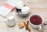 Black tea with milk. Cane sugar and cinnamon sticks