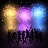 Party crowd on fireworks background