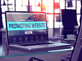 Laptop Screen with Promoting Website Concept.