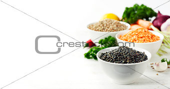 Bowls of assorted dried lentils with vegetables