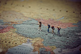 Miniature tourists in China. Color tone tuned.