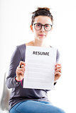 serious woman showing a resume
