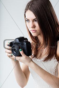 beautiful girl holding a reflex camera