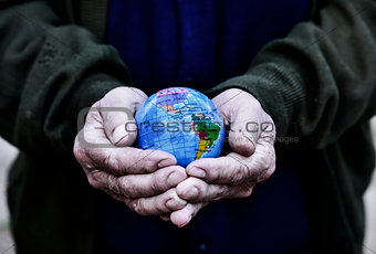 old man with a world globe in his hands