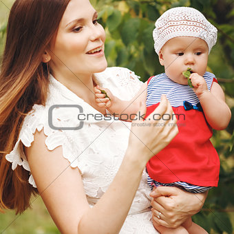 Portrait of Happy Young Mother Holding Her Baby
