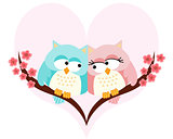 Owls couple in love on background of a heart